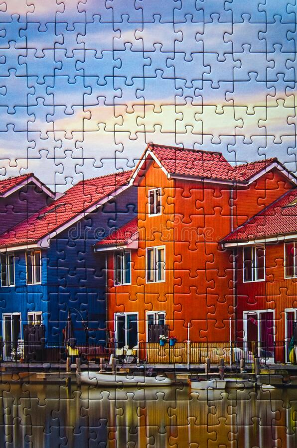 Groningen in Holland colorful houses assembled puzzle image. A commercial toy, Polish manufacturer Trefl puzzle consisting of 1000 elements, assembled puzzle stock photo