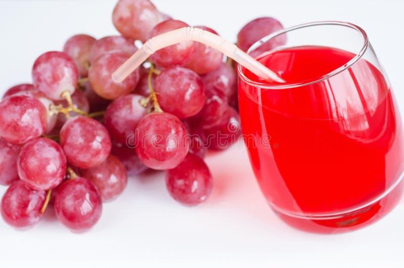 Gronowy sok w szkle i jagodach zdjęcia stock