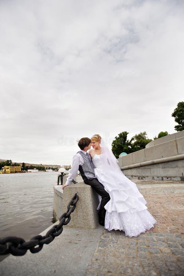 Download Groom Adn Bride For Walk On Embankment River Stock Photo - Image: 12569070