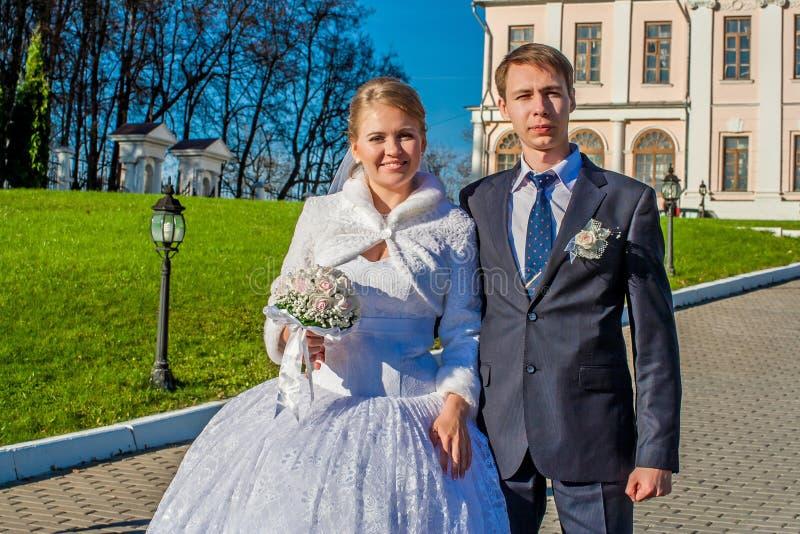 Groom ang bride on the promenade stock photos