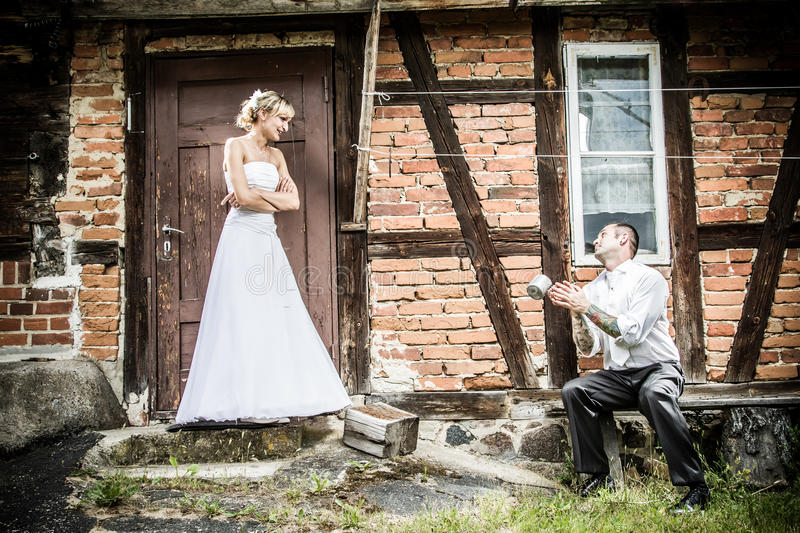 The groom apologized before the house of the bride stock photo