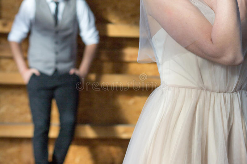 The groom in the background, the bride in the foreground. stock image