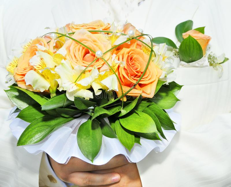 Groom with bouquet stock photo