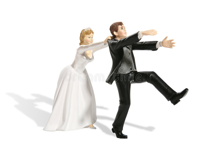 Groom and Bride. A funny figurine of a groom having second thought at his wedding