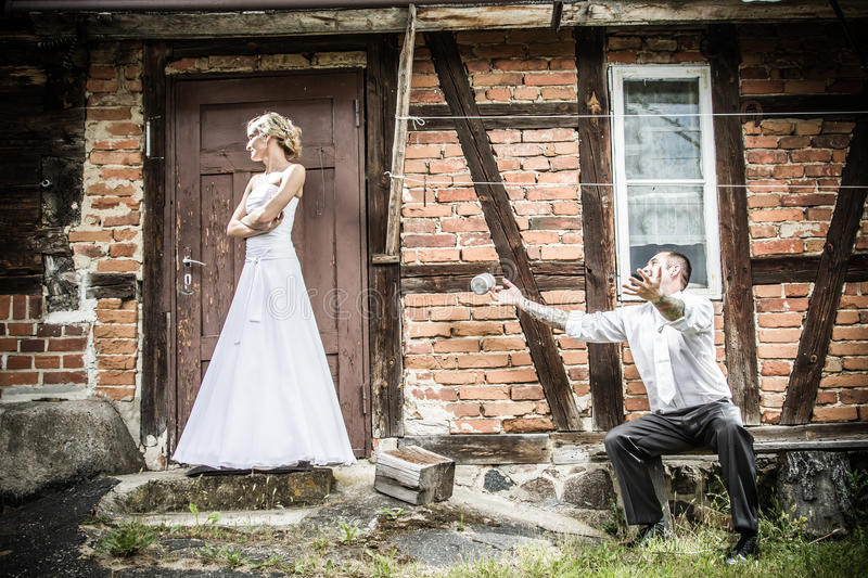 The groom bride apologizes royalty free stock photography