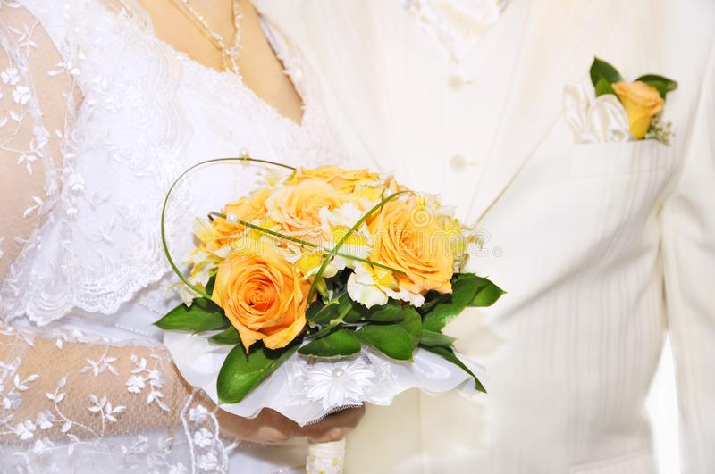 Groom and bride with bouquet royalty free stock photography