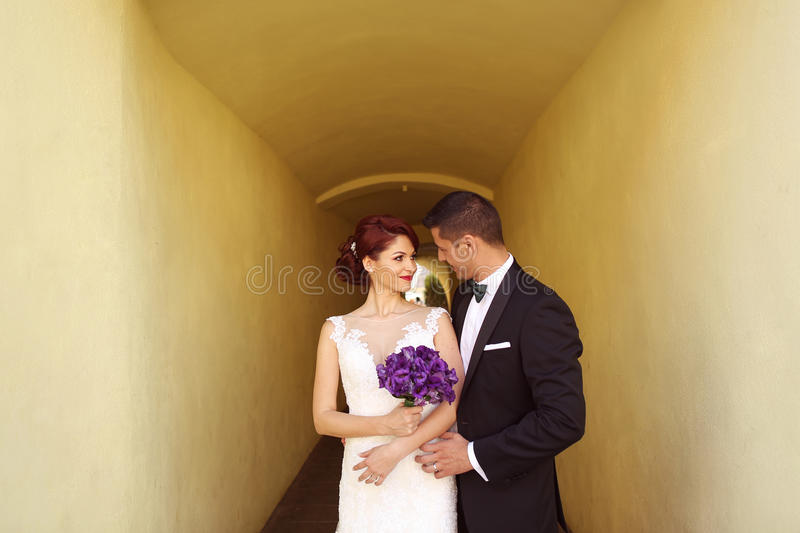 Groom and bride in the city. Bride and groom posing in the city stock images