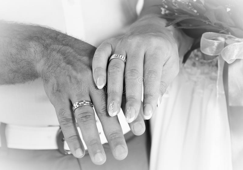Groom and bride hands with wedding rings, bw royalty free stock images