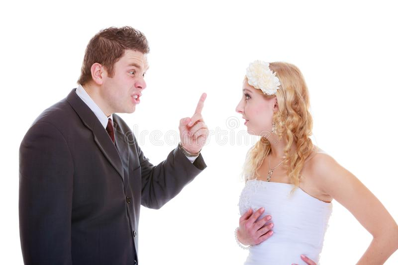 Groom and bride having quarrel argument. Relationship problems and troubles concept. Groom and bride having quarrel argument stock photos