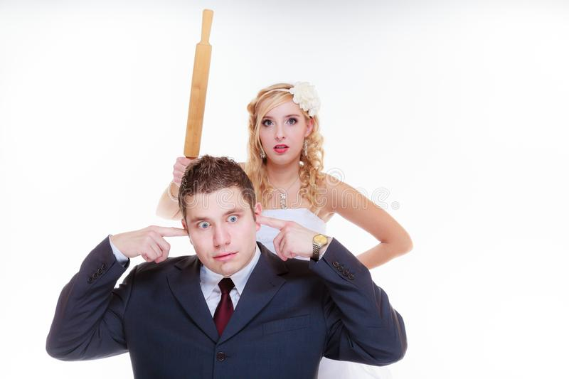 Groom and bride having quarrel argument. Relationship problems and troubles concept. Groom and bride having quarrel argument, women holding rolling pin stock images