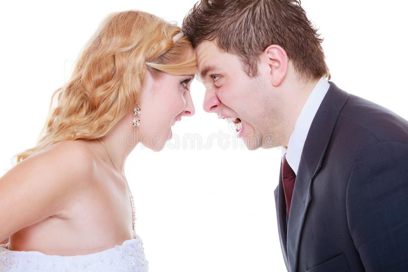 Groom and bride having quarrel argument. Relationship problems and troubles concept. Groom and bride having quarrel argument, yelling at each other with wide stock photo