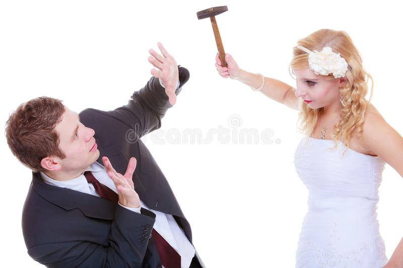 Groom and bride having quarrel argument. Relationship problems and troubles concept. Groom and bride having quarrel argument, women holding hammer stock photos