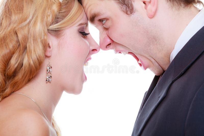 Groom and bride having quarrel argument. Relationship problems and troubles concept. Groom and bride having quarrel argument, yelling at each other with wide stock images