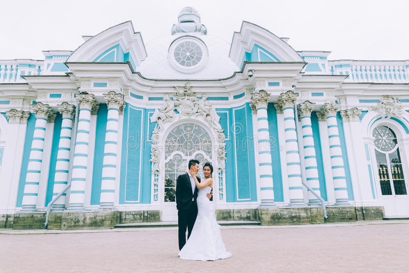 Groom and bride. Kiss near Wedding palace stock image