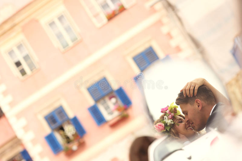 Groom and bride kissing royalty free stock image