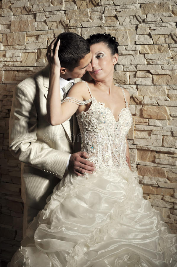Download Groom And Bride Near The Brick Wall Stock Photo - Image of adults, dark: 17441124