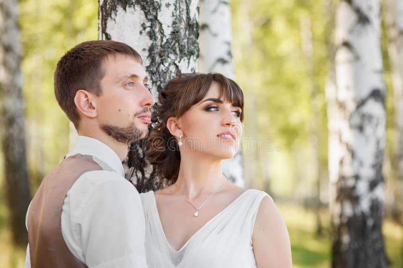 Groom and bride outdoors stock image