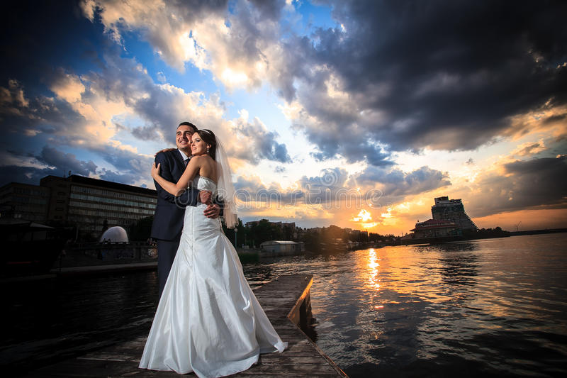 Groom, bride, sunset, clouds. The wedding ceremony beautiful bride and groom stylish summer fun smile joy royalty free stock photos