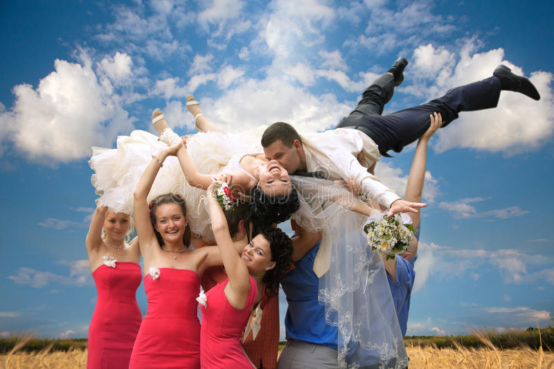 Groom and bride tossed into sky royalty free stock photos