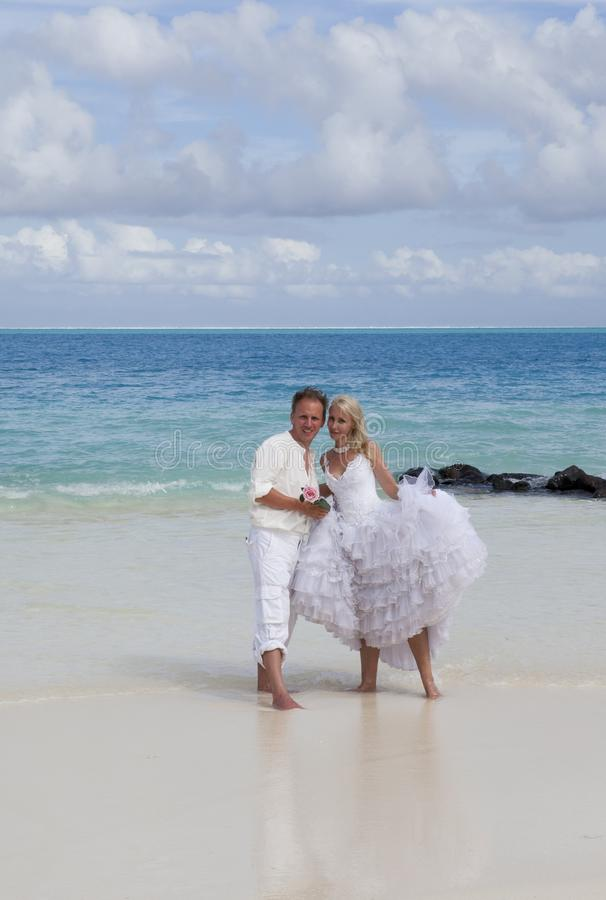 The groom and the bride on the tropical beach stock photo