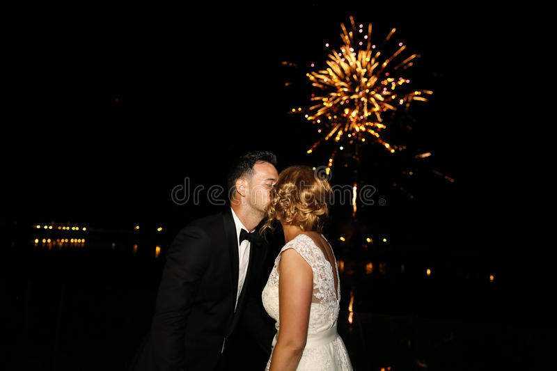 Groom and bride watching the fireworks. Bridal couple watching the fireworks royalty free stock photos