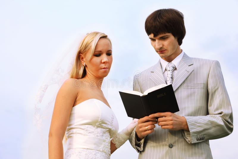 Download Groom And Bride Wearing White Dress Read Bible Stock Photos - Image: 21830893