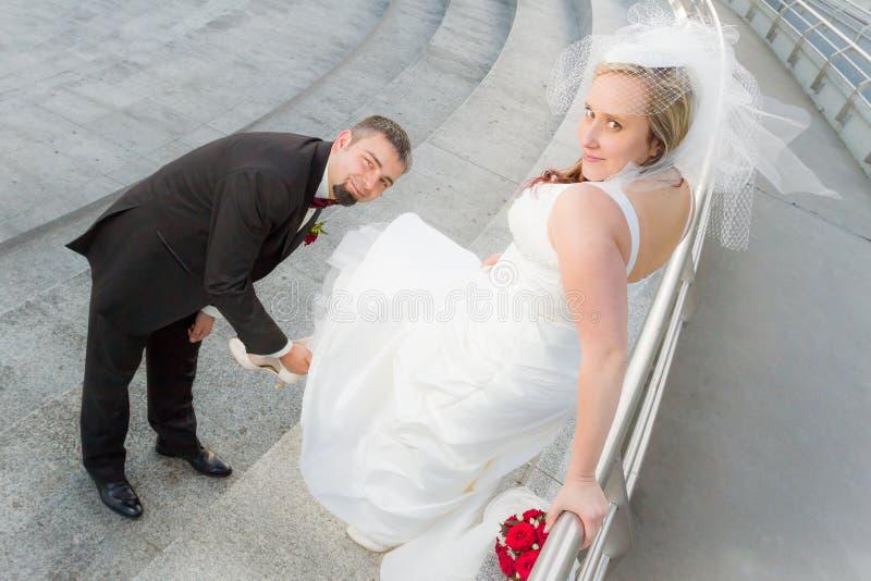 The groom bride wears slipper stock image