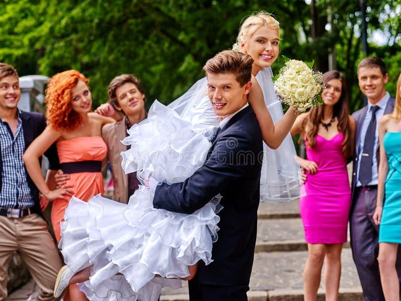 Download Groom Carries His Bride Over Shoulder Stock Photo - Image: 54011224