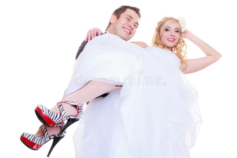Groom carry bride in his arms. Positive relationship couples concept. Happy groom and bride posing for marriage photo waiting for the big day, he carry women in royalty free stock images