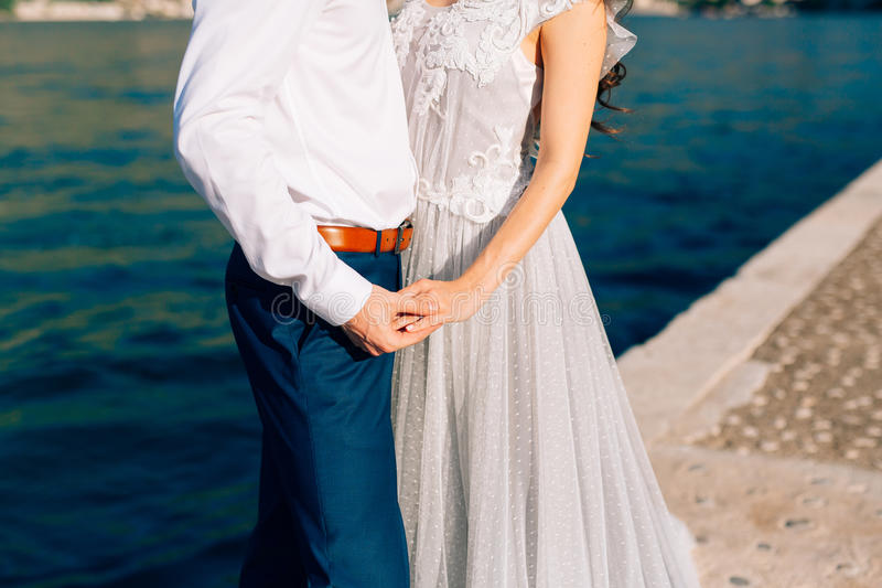 The groom embraces the bride on the beach. Wedding in Montenegro. And Croatia stock photo