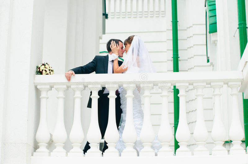 Groom embracing bride and tender touching. Love couple stock photo
