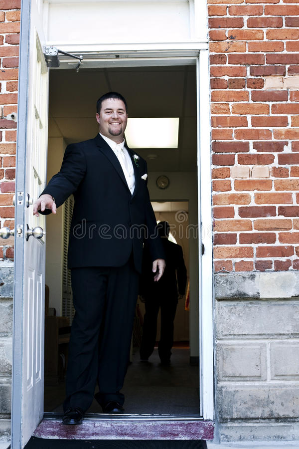Free Groom Entering Church Stock Photography - 15942502