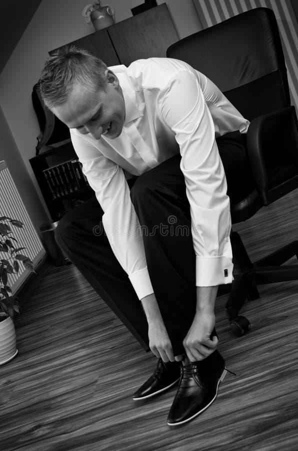 Groom getting dressed royalty free stock image