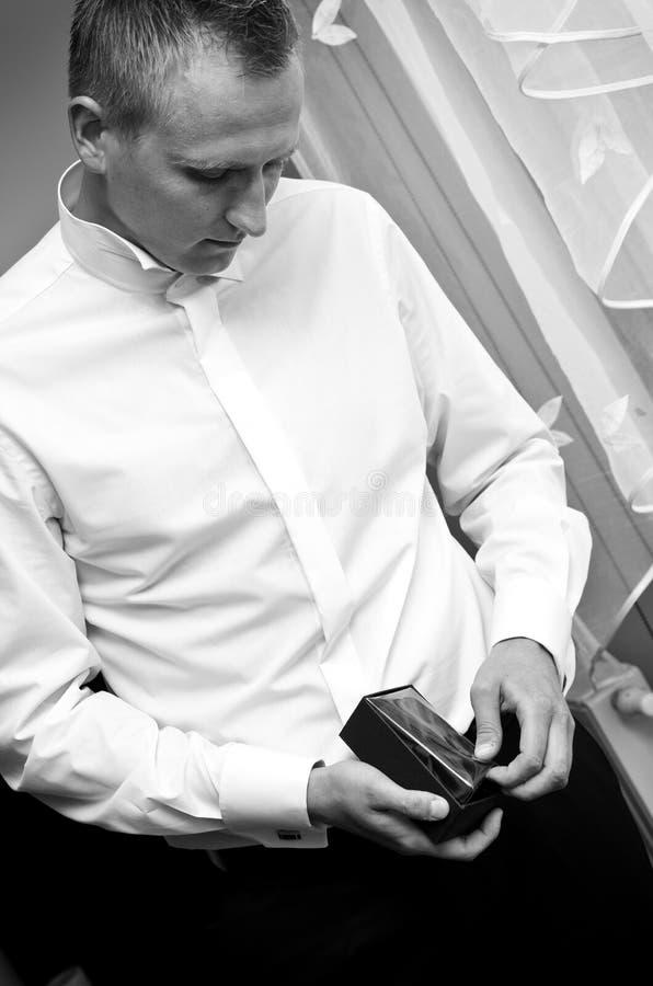 Groom getting dressed stock photos