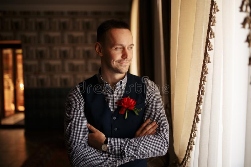 Groom getting ready in the morning for wedding ceremony stock photography