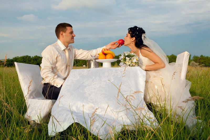 Groom giving an apple to bride royalty free stock photo
