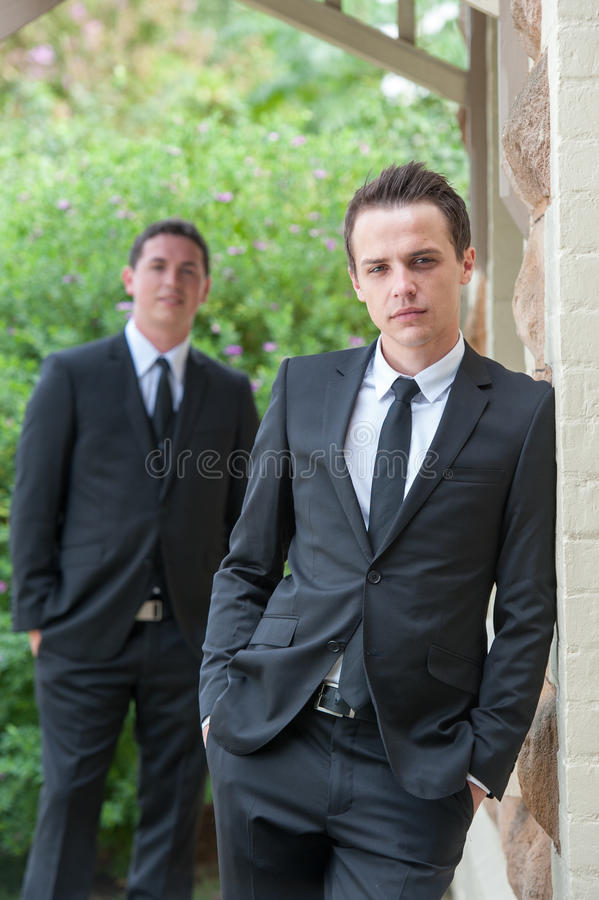 Groom with his best man in the back ground stock photography