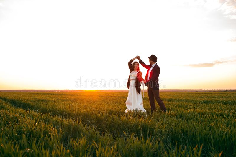 Groom holding bride in dance pose on wedding dayThe groom holds the bride in a dance pose on the wedding day, a young couple royalty free stock photos