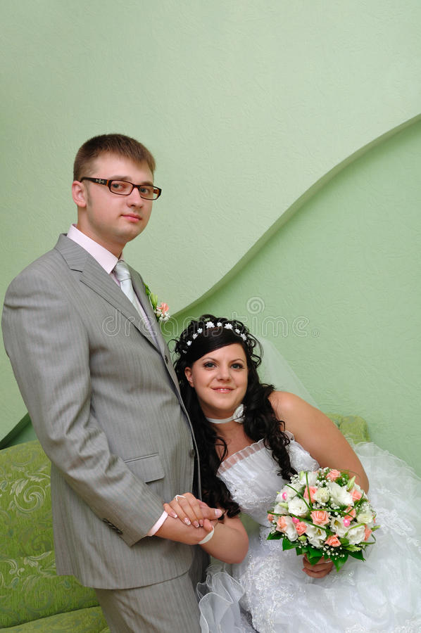 Groom and bride indoors stock photography