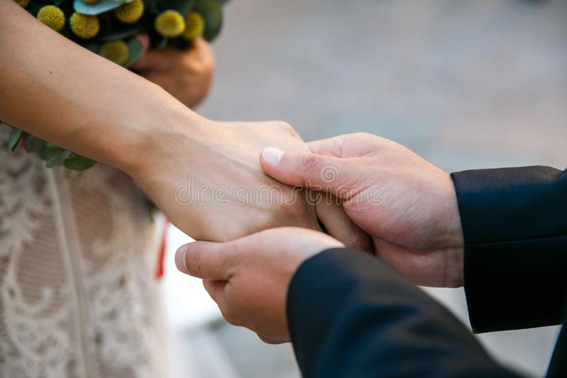 Groom holds bride`s hand before the ceremony royalty free stock image