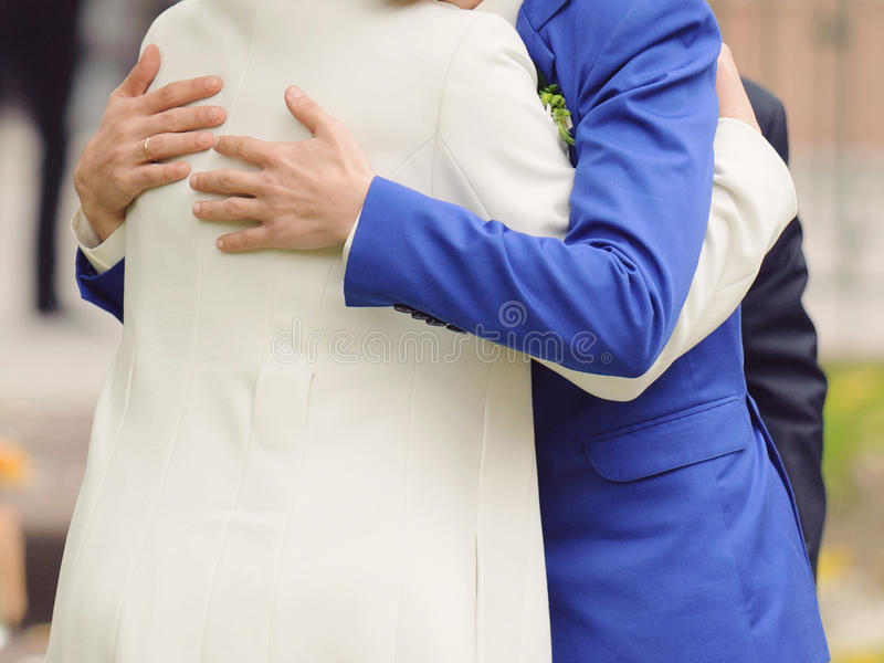 Groom Hugging Mother royalty free stock image