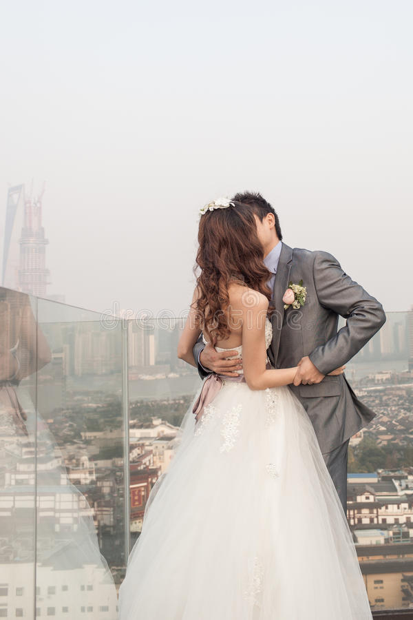 Groom Kissing Bride Standing  Ouside With Huangpu River Stock Photos