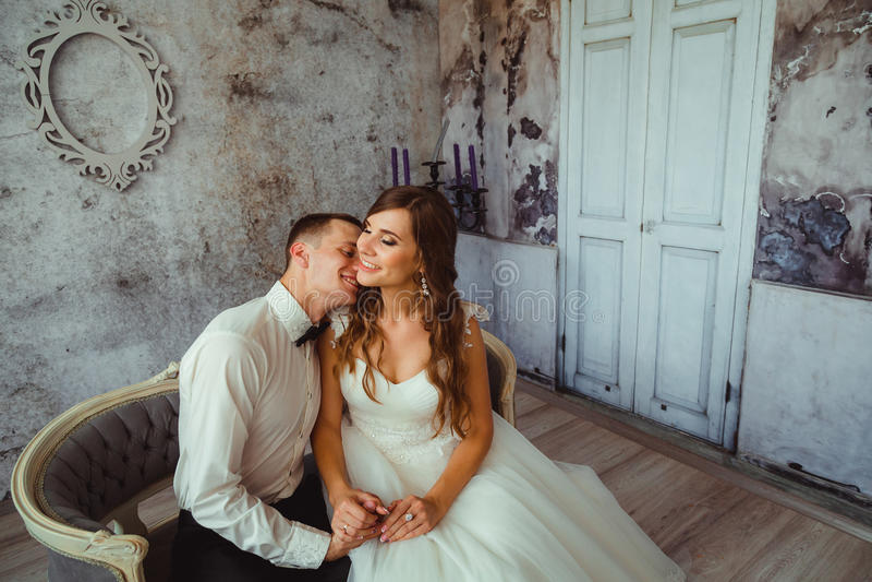 Groom lies on bride& x27;s shoulder stock photography