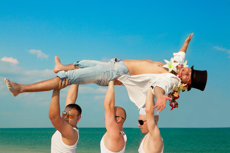 Download Groom Is Lifted Into Blue Sky Royalty Free Stock Photo - Image: 20363035