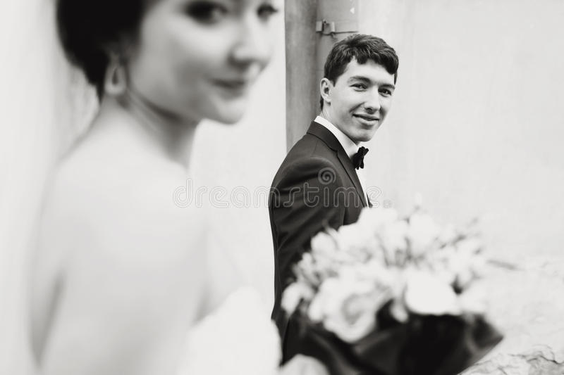 Groom looks tenderly at the sad bride. A royalty free stock photos