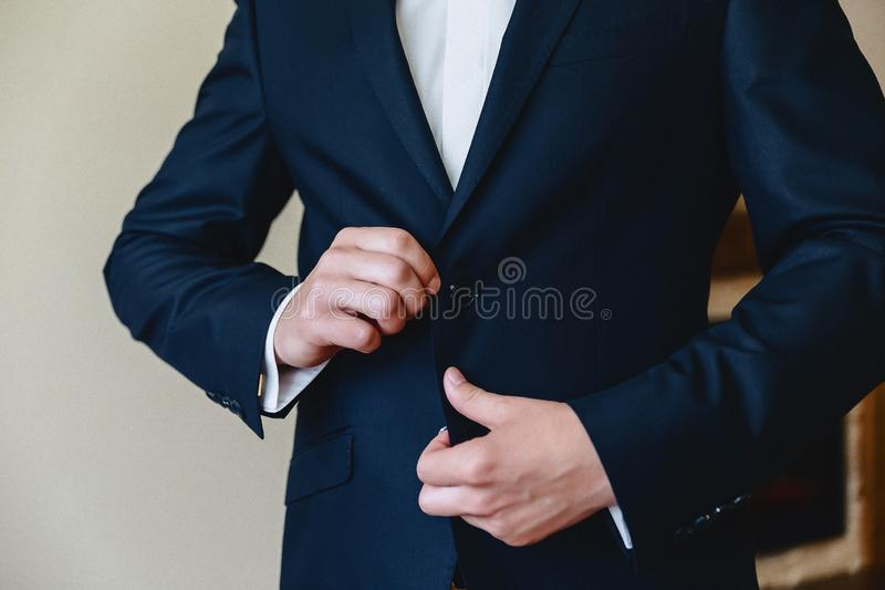 Groom meeting, details, jacket, shoes, watches and buttons on the wedding day royalty free stock images