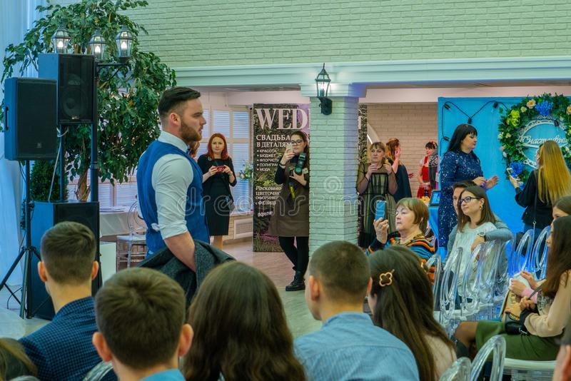 A groom model in a vest at the wedding exhibition. Wedding hassle 2019 took place in Kirov, Russia stock photography