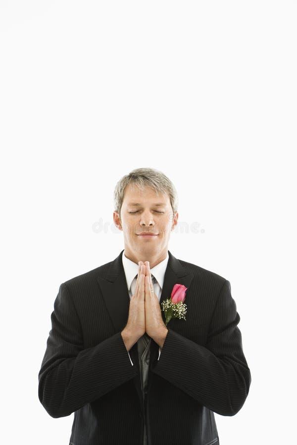 Groom praying. royalty free stock photo