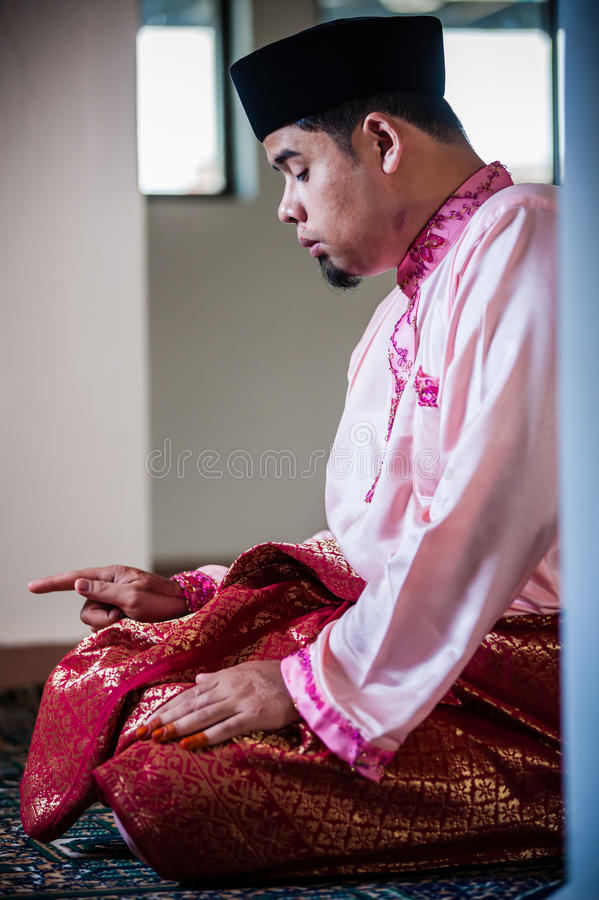 The Groom Praying royalty free stock photography