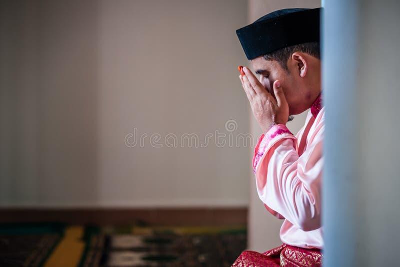 The Groom Praying royalty free stock photos